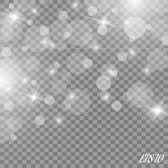 Staubweiß. weiße funken und goldene sterne leuchten mit besonderem licht. funkelt auf einem transparenten hintergrund. . funkelnde magische staubpartikel.