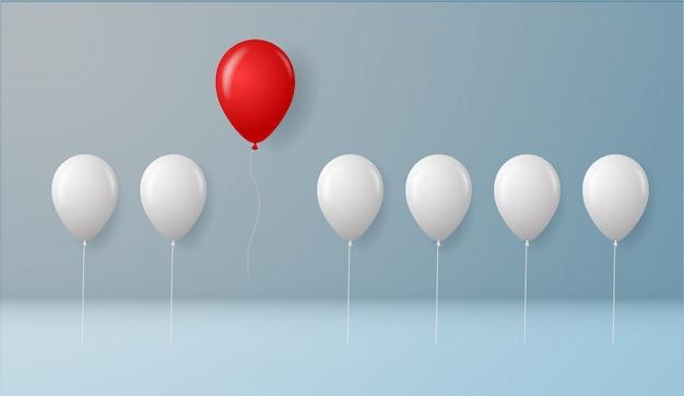 Stehen sie heraus von der masse und vom unterschiedlichen konzept, ein roter ballon, der weg von anderen weißen ballonen auf wandhintergrund mit schatten fliegt. erfolgskonzept