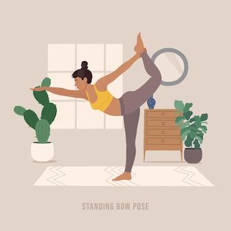 Stehende bogenpose pose junge frau praktiziert yoga-pose
