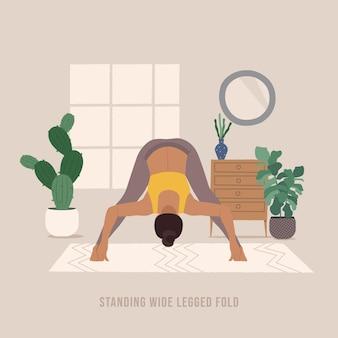 Stehende breitbeinige falten-pose junge frau, die yoga-pose praktiziert