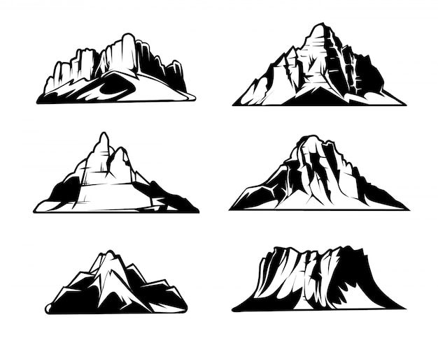 Steine und naturfelsen stellten mit grünem gras der karikatur ein. vector die gesetzten illustrationen des steins und des felsens, die auf weißem hintergrund lokalisiert werden