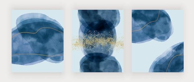 Stellen sie blaue pinselstrich-aquarelltextur mit goldenen linien und konfetti ein