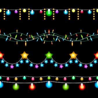 Stellen sie farbige weihnachtslichter auf dunklem hintergrund ein