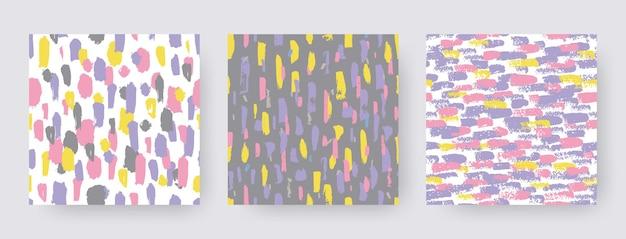 Stellen sie handgezeichnete moderne muster des pinselstrichs ein. vektor nahtlose texturformen. abstrakte hintergründe in boho-farbe. dekorativer druck