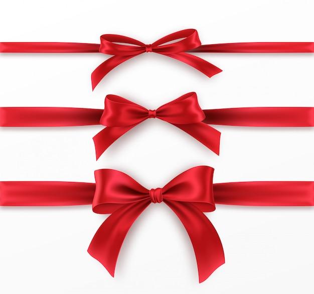 Stellen sie rote schleife und band auf weißem hintergrund ein. realistische rote schleife.