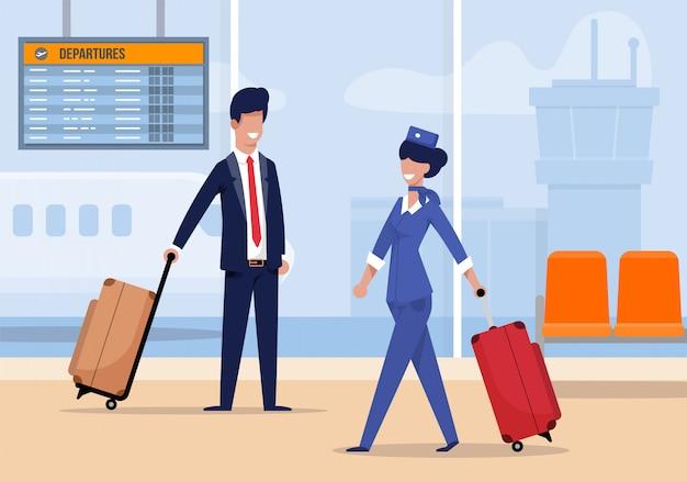 Stewardess am flughafen kommt mit koffer flach.
