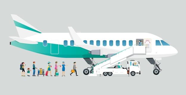 Stewardessen ermöglichen es den passagieren, mit grauem hintergrund in das flugzeug einzusteigen.
