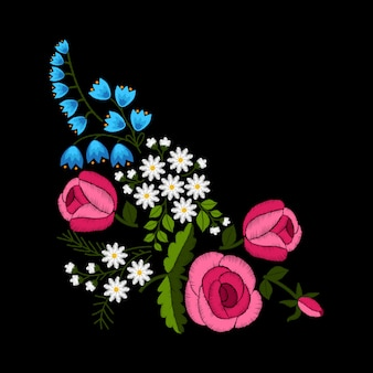 Stickerei frühlingsblumen und rosen auf schwarzem hintergrund.
