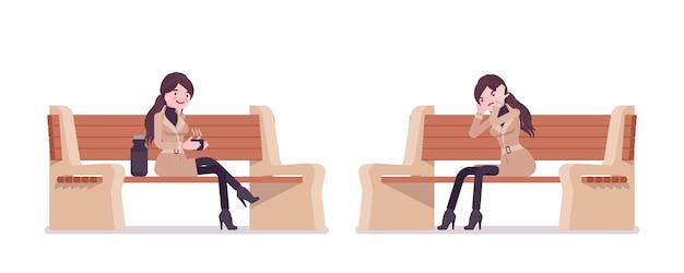 Stilvolle frau, die auf einer bank sitzt, die herbstkleidungsillustration trägt