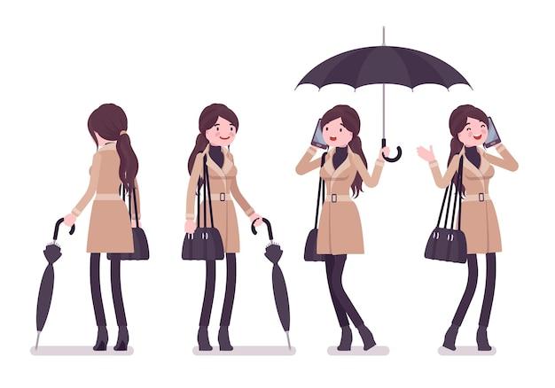 Stilvolle frau, die mit regenschirm steht, der herbstkleidillustration trägt