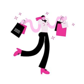 Stilvolle tragende einkaufstaschen der jungen frau auf beiden händen