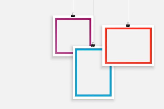 Stilvolles hintergrunddesign für drei leere fotorahmen