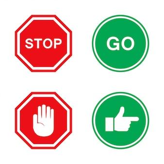 Stop and go schilder in rot und grün mit der hand