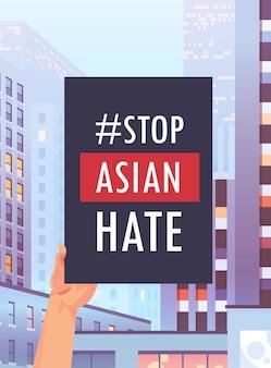 Stoppen sie asiatischen hass. menschliche hand hält banner gegen rassismus. unterstützung während der covid-19-coronavirus-pandemie