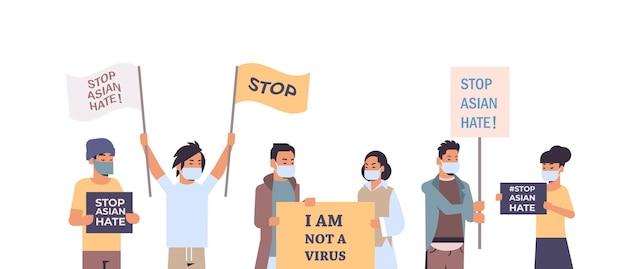 Stoppen sie asiatischen hass. mischen sie rassenmenschen in masken, die plakate gegen rassismus halten. unterstützen sie menschen während der covid-19-coronavirus-pandemie