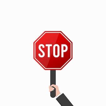 Stoppschild in der hand auf weißem hintergrund