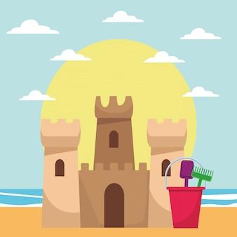 Strandspielzeug und sandburg