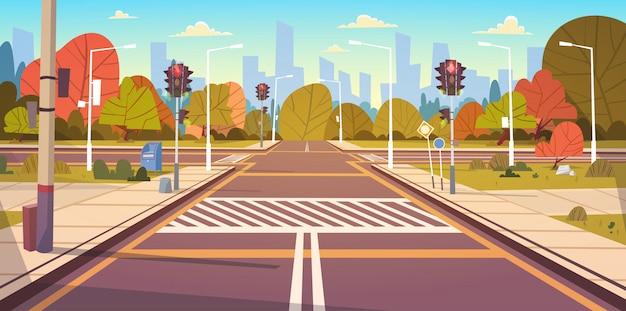 Straßen-leere stadtstraße mit zebrastreifen und ampeln