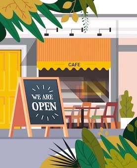 Straßencafé fassade mit wir sind offenes brett städtisches gebäude haus außen coronavirus quarantäne ist vorbei