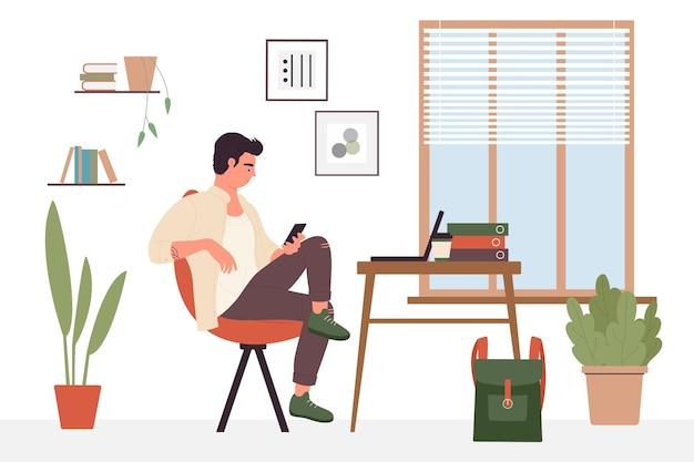 Student, der jungen mann des fernunterrichts mit telefon studiert, das drinnen im heimbüro sitzt