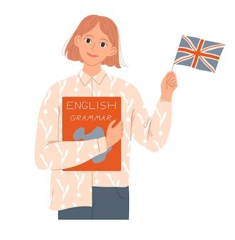 Studentin hält ein buch und eine englische flagge. sie ist muttersprachlerin oder lernt englisch.