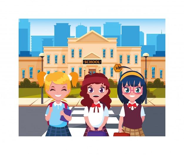 Studentinnen mit schulgebäude der grundschule
