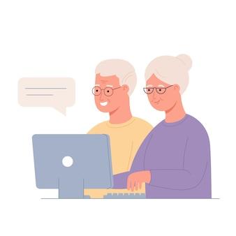 Studieren des computers durch das konzept älterer menschen technologie verbreitet das aktive soziale leben der älteren bildung