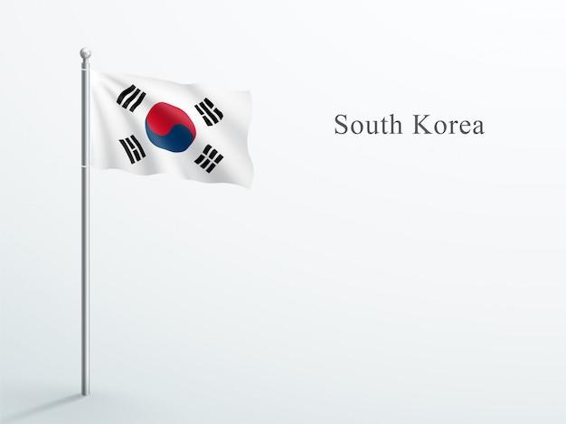 Südkorea-flagge, die auf stahlfahnenmast weht