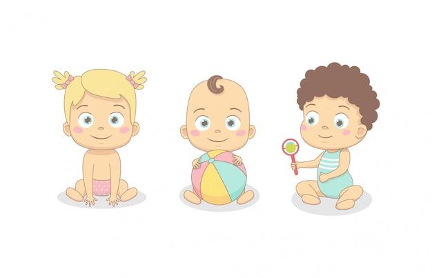 Süße babys spielen. kleine mädchen und jungen spielen, kriechen.
