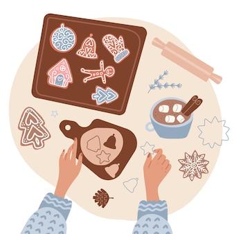 Süße hausgemachte weihnachtsbäckerei zwei hände einer frau, die einen teig rollt und lebkuchen auf...