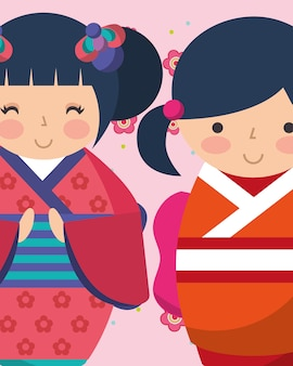 Süße japanische kokeshi puppen im kimono