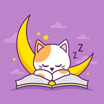 Süße katze, die auf dem buch schläft