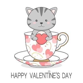 Süße katze in einer tasse, die herz-valentinstag hält
