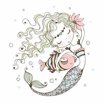 Süße kleine meerjungfrau mit einem fisch