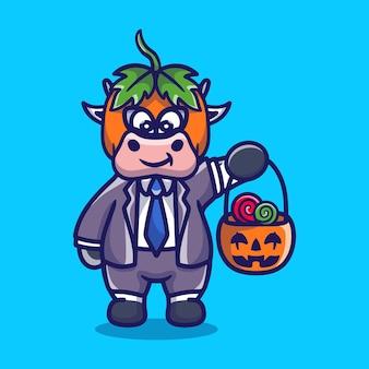 Süße kürbiskuh bringt halloween süßigkeiten