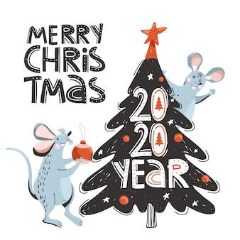 Süße mäuse schmücken den weihnachtsbaum.