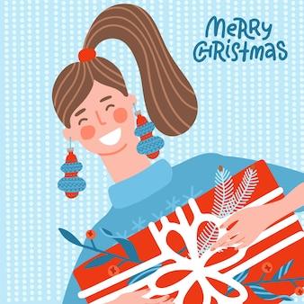 Süße smiley-frau mit einem großen geschenkkarton junge frau im blauen pullover glücklich lächelnde charakter i... Premium Vektoren