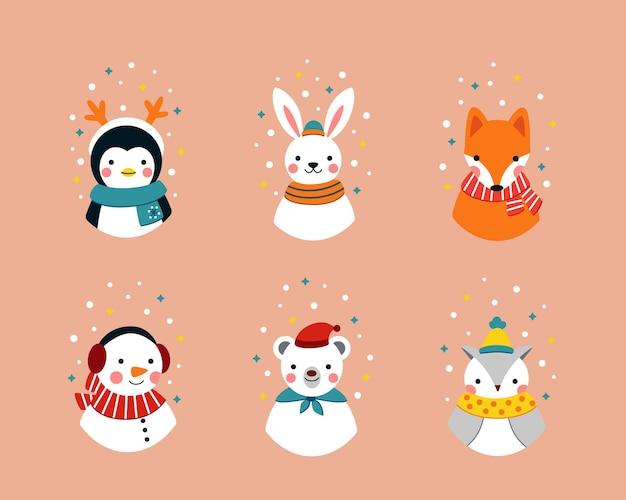 Süße winteraufkleber mit cartoon-waldtieren in warmer kleidung