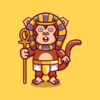 Süßer affen-pharao mit einem stock
