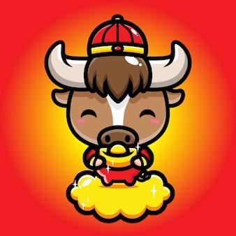 Süßer büffel, der einen klumpen gold hält