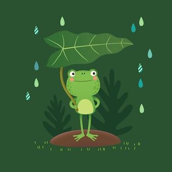 Süßer frosch, der ein blatt an einem regnerischen tag steht und hält.