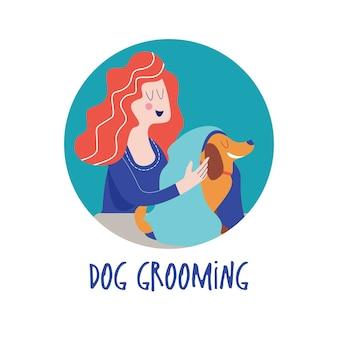 Süßer hund im friseursalonfrau wischt mit handtuchhund hundepflegekonzept