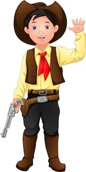 Süßer junge, der kostümcowboy trägt