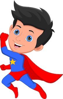 Süßer junge im superheldenkostüm