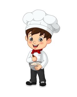 Süßer koch des kleinen jungen, der zutaten in der schüssel mischt