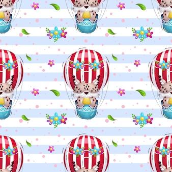 Süßer luchs fliegt in einem heißluftballonmuster