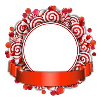Süßer rahmen von roten und weißen bonbons mit rotem band