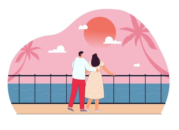 Süßes cartoon-paar, das zusammen den sonnenuntergang auf dem meer beobachtet