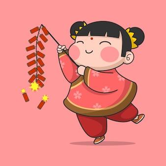 Süßes chinesisches neujahrsmädchen, das kracher spielt