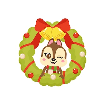 Süßes eichhörnchen feiert weihnachten im dekorationskranz